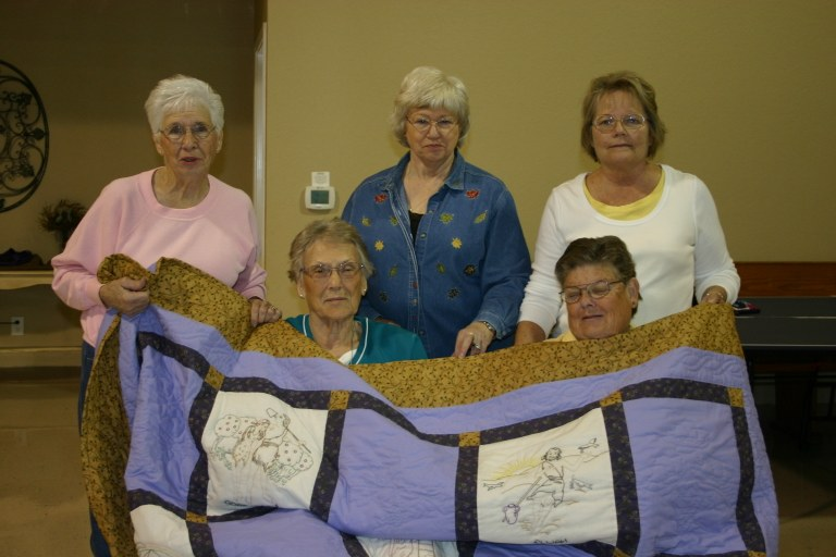 Quilt with ladies